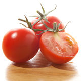 Red tomatoes  on white background. Red cherry tomatoes  on white background Royalty Free Stock Photography