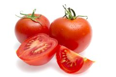 Red tomatoes on a white background royalty free stock image