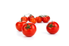 Red tomatoes on a white background Stock Image