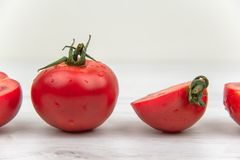 Red tomatoes on the white wood table stock photos
