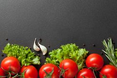 Red Tomatoes With Green Salad On Black Stock Photos