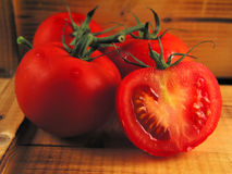 Red tomatoes on wood. Still of tomatoes in rustical atmosphere Royalty Free Stock Images