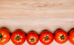 Red tomatoes on wooden ground Stock Images