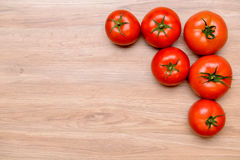 Red tomatoes on wooden ground Royalty Free Stock Image