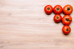 Red tomatoes on wooden ground Stock Photos
