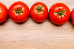 Red tomatoes on wooden ground Stock Image