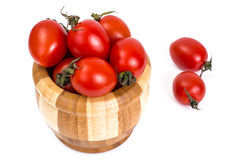Red tomatoes in wooden salad bowl. Studio Photo Royalty Free Stock Photography