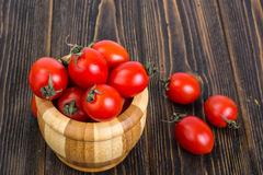 Red tomatoes in wooden salad bowl. Studio Photo Royalty Free Stock Images