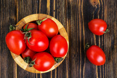 Red tomatoes in wooden salad bowl. Studio Photo Royalty Free Stock Image