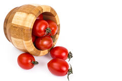 Red tomatoes in wooden salad bowl. Studio Photo Royalty Free Stock Photo