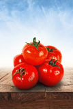 Red tomatoes on wooden table Royalty Free Stock Images
