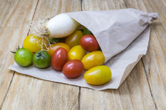 Red tomatoes, yellows, greens and scallions Royalty Free Stock Photos
