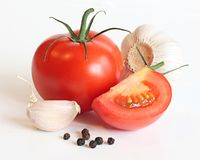 Red tomatos , garlic and pepper Stock Image