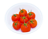 Red tomatos in round plate Stock Photo