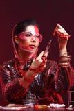 Red Tone Fashion Scientist in Dark room laboratory with tools la Stock Image