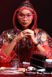 Red Tone Fashion Scientist in Dark room laboratory with tools la Stock Photography