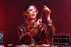 Red Tone Fashion Scientist in Dark room laboratory with tools la Royalty Free Stock Photography
