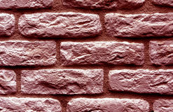 Red toned brick wall surface. Royalty Free Stock Photos