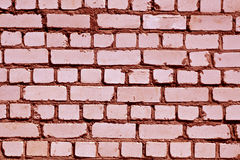 Red toned rough brick wall pattern. Stock Photo