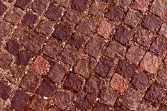 Red toned stone pavement texture. Royalty Free Stock Photos
