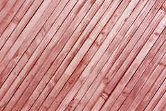Red toned wood wall texture. Royalty Free Stock Image