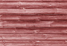 red toned wooden wall texture. Stock Photo