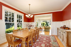 Red tones interior of American classic dining room Royalty Free Stock Photo