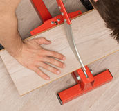 Red tool for cutting laminate royalty free stock photography