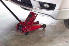 Red tool hydraulic jack lift car. For Maintenance of cars for repair stock images