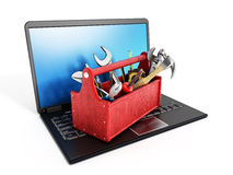 Red toolbox standing on laptop computer Royalty Free Stock Image