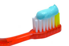 Red Toothbrush and Toothpaste Stock Photo