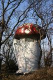 Red Top Mushroom Building. An unusual outhouse or lavatory in the shape of a mushroom with a red polka dot roof Stock Image