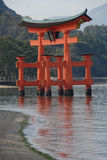 Red torii gate. Red floating torii gate outside Itsukushima Shrine at Miyajima at low tide (one of the three most photographed places in Japan Royalty Free Stock Photo