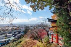 Red Torii gate in Arakura Sengen shrine with mount Fuji in autum. N season Royalty Free Stock Photos