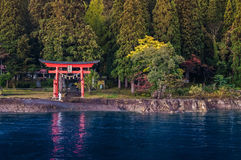Red Torii of Shrine at Lake Tazawa, Senboku, Akita, Japan. Royalty Free Stock Photography