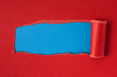 Red torn paper with blue space for text Royalty Free Stock Images