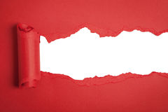 Red torn paper revealing a white background. Red torn paper space for text royalty free stock photos