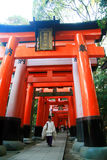 Red Torri. Travel Shrine monk shinto Torii Gate japan Kyoto Stock Photo