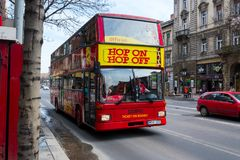Red tourist bus on the road in Budapest Stock Image