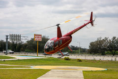 Red tourist helicopter takes off  for sightseeing journey in Orlando Royalty Free Stock Image