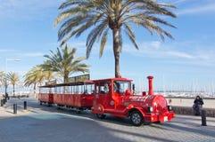 Red tourist train. CAN PASTILLA, MALLORCA, SPAIN - APRIL 30, 2016: Red tourist train in spring sunshine in Can Pastilla, Mallorca, Spain on April 30, 2016 Royalty Free Stock Images