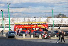 Red touristic bus drives in Moscow city center Royalty Free Stock Photography