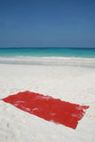 Red towel on beatiful beach Royalty Free Stock Photography