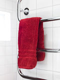 Red towel on a dryer Royalty Free Stock Images