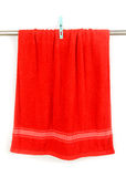 Red towel hang on rack with clip Royalty Free Stock Photo