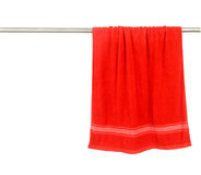 Red towel hang on rack. Isolated on white Stock Photography