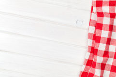 Red towel over wooden kitchen table Royalty Free Stock Image