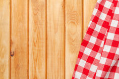 Red towel over wooden kitchen table Stock Images