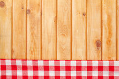 Red towel over wooden kitchen table Royalty Free Stock Photography