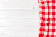 Red towel over wooden kitchen table Stock Photos